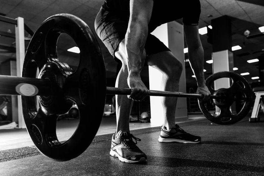 Man weightlifting for health benefits