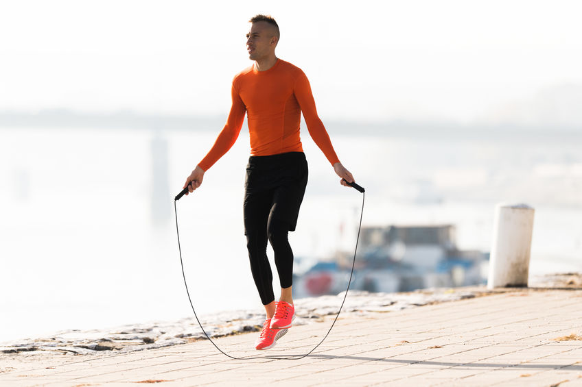 man jumping rope using these 5 tips for staying fit on the road